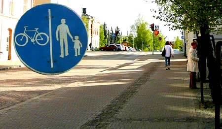 Rough textured paving dividing pedestrian and cycle paths in Oulu, Finland